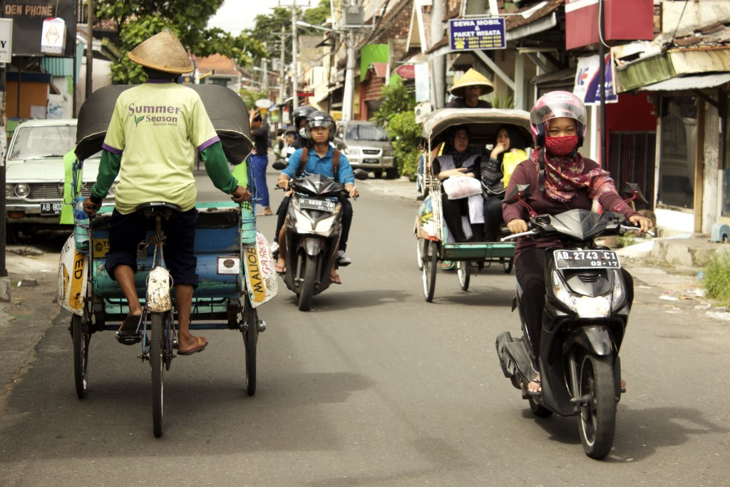Becaks and scooters are the preferred modes of transport in the busy city centre of Yogyakarta